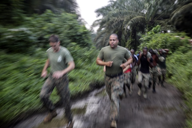 Sgt. Edgar Rodriguez, a rifleman with Special Purpose Marine Air-Ground Task Force Crisis Response-Africa, runs with Cameroonian soldiers with Forces Fusiliers Marins et Palmeurs de Combat during a physical training exercise in Limbé, Cameroon, June 29, 2016.  Marines share tactics, techniques and skills with the FORFUMAPCO soldiers to combat the illicit trafficking in Cameroon.  (U.S. Marine Corps photo by Cpl. Alexander Mitchell/released)