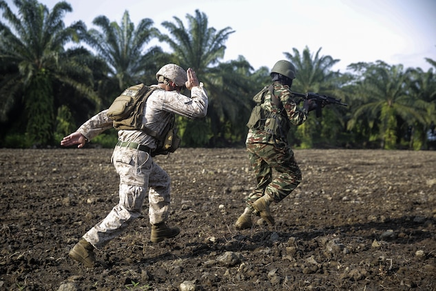 Cpl. Jeremy Osteen, a squad leader with Special Purpose Marine Air-Ground Task Force Crisis Response-Africa, runs behind a Cameroonian soldier with Forces Fusiliers Marins et Palmeurs de Combat as he conducts a buddy rush on the range in Limbé, Cameroon, July 1, 2016.  Marines share tactics, techniques and skills with the FORFUMAPCO soldiers to combat the illicit trafficking in Cameroon.  (U.S. Marine Corps photo by Cpl. Alexander Mitchell/released)