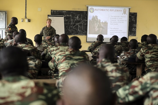 Lance Cpl. Dustin Kitts, a rifleman with Special Purpose Marine Air-Ground Task Force Crisis Response-Africa, instructs Cameroonian soldiers with Forces Fusiliers Marins et Palmeurs de Combat about fire team formations and patrols in Limbé, Cameroon, June 27, 2016.  Marines share tactics, techniques and skills with the FORFUMAPCO soldiers to combat the illicit trafficking in Cameroon.  (U.S. Marine Corps photo by Cpl. Alexander Mitchell/released)