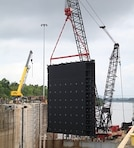 Crews working for the U.S. Army Corps of Engineers lifted the first of two Miter Gates into place on July 29, 2016, at the Greenup Locks and Dam on the Ohio River in Greenup, Ky. 
