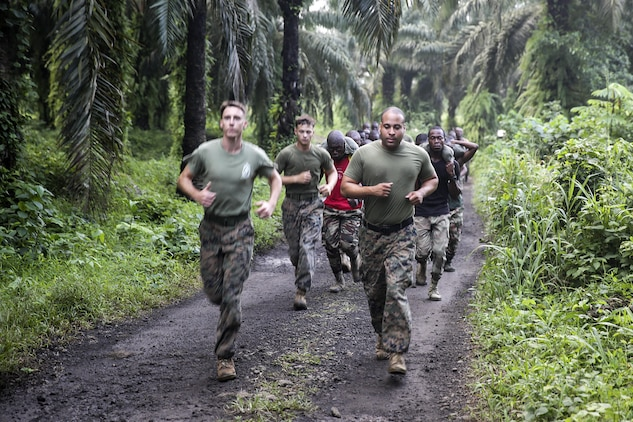 Three Marines with Special Purpose Marine Air-Ground Task Force Crisis Response-Africa, run with Cameroonian soldiers with Forces Fusiliers Marins et Palmeurs de Combat during a physical training exercise in Limbé, Cameroon, June 29, 2016.  Marines share tactics, techniques and skills with the FORFUMAPCO soldiers to combat the illicit trafficking in Cameroon.  (U.S. Marine Corps photo by Cpl. Alexander Mitchell/released)