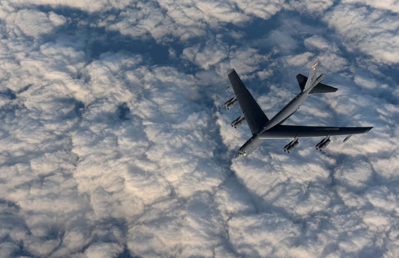 A KC-135 Stratotanker from RAF Mildenhall, England, refuels a B-52 Stratofortress from Minot Air Force Base, North Dakota, in support of Operation Polar Roar over Scotland, Aug. 1, 2016. Polar Roar is a U.S. Strategic Command operation designed to strengthen bomber crews' interoperability and demonstrate ability for the U.S. bomber force to provide flexible and vigilant long-range global-strike capability. (U.S. Air Force photo by Staff Sgt. Kate Thornton)