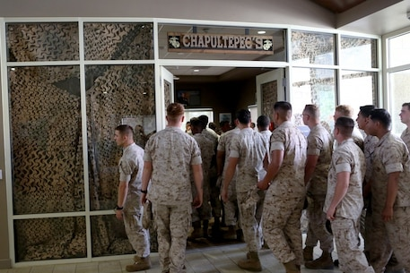 U.S. Marine non-commissioned officers from 7th Engineer Support Battalion, 1st Marine Logistics Group, enter their new NCO lounge, known as Chapultepec's, in their barracks building aboard Camp Pendleton, Calif., April 15, 2016. The newly opened lounge is dedicated to give the NCOs a place in the barracks to come together and unwind, forming stronger camaraderie in their ranks. (U.S. Marine Corps photo by Cpl. Carson Gramley/released)