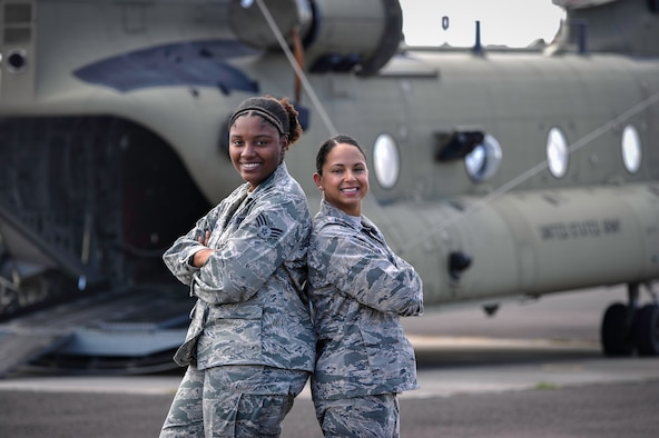 U.S. Air Force Capt. Amber El-Amin, Joint Task Force-Bravo Operations Medical Planner, and Senior Airman Synethia Robinson, JTF-Bravo medical operations noncommissioned-officer-in-charge, pose behind a 1st Battalion, 228th Aviation Regiment CH-47 Chinook helicopter July 25, 2016 at Soto Cano Air Base, Honduras. The aircraft is being loaded in preparation for a Medical Readiness Exercise mission in the Colón department of Honduras. The duo spends approximately 180-200 hours over 12 weeks preparing for each MEDRETE - events that have been the backbone of JTF-Bravo's humanitarian mission in Central America for the past 23 years and have touched the lives of hundreds of thousands of people, built partner nation capacity and fostered goodwill towards the U.S. in the region. (U.S. Air Force photo by Staff Sgt. Siuta B. Ika)