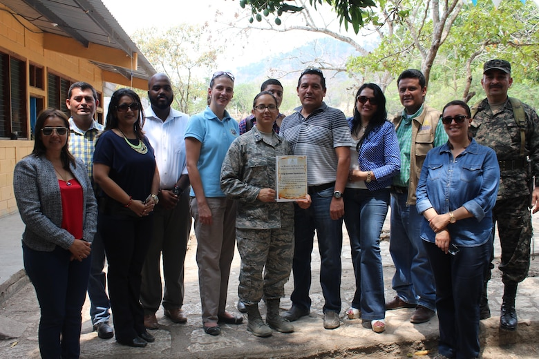 U.S. Air Force Capt. Amber El-Amin (left), Joint Task Force-Bravo Operations Medical Planner, is presented an appreciation award for the support given to the people of Copán by JTF-Bravo service members, in Ostumán, Copán, Honduras, April 28, 2016. The Regional Director visited the Medical Readiness Training Exercise location as part of a Civic Leader Engagement between regional key leaders, U.S. Embassy personnel and JTF-Bravo representatives. (U.S. Army photo by Maria Pinel)