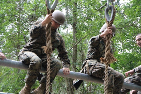 FMTB-E student participates on the obstacle course.  The obstacle is designed to test students strength and ability to safely move past obstacles.