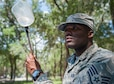 Staff Sgt Derrick Jones, 96th Aerospace Medicine Squadron public health technician, checks for mosquito larvae using a larvae dipper July 20 at Eglin Air Force Base, Fla. Jones checks the retention ponds and standing water after rainy weather periods for mosquito larvae. If larvae are found, they are collected, preserved and shipped to a lab for testing. (U.S. Air Force photo/Ilka Cole)