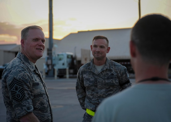Chief Master Sgt. of the Air Force James A. Cody speaks with Airmen from Joint Base Langley-Eustis, Va. during a meet and great on the flightline at Nellis Air Force Base, Nev., July 27, 2016. During Cody's visit, Airmen from around the Air Force are temporarily deployed to Nellis AFB for Red Flag 16-3 where they will train for three weeks in air, space and cyberspace. (U.S. Air Force photo by Senior Airman Jake Carter/Released)