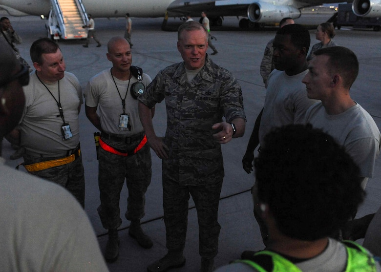 Chief Master Sgt. of the Air Force James A. Cody speaks with Airmen assigned to an E-8 Joint Stars from Robins Air Force Base, Ga. during a meet and great on the flightline at Nellis AFB, Nev., July 27, 2016. During the conversations, Cody would ask Airmen what their biggest concerns are for the Air Force and offered guidance on how the leadership of the U.S. Air Force is handling the situation. (U.S. Air Force photo by Senior Airman Jake Carter/Released)
