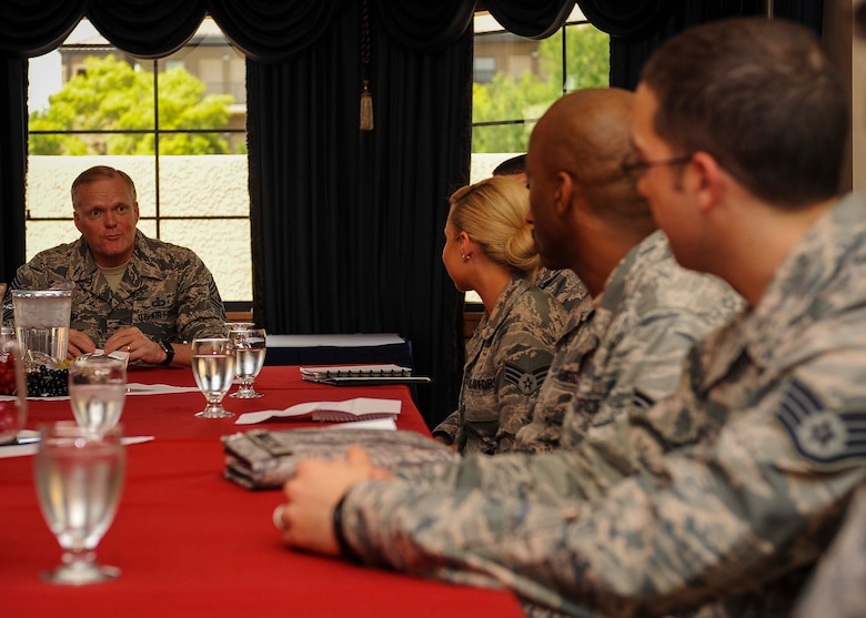 Chief Master Sgt. of the Air Force James A. Cody has a discussion with Airmen during a meet and greet in the Thunderbird room located at the club on Nellis Air Force Base, Nev., July 27, 2016. While meeting with Airmen, Cody discussed Air Force topics that may relate to an Airmen's career field and asked Airmen their opinions on how to make the Air Force better as a whole. (U.S. Air Force photo by Senior Airman Jake Carter/Released)