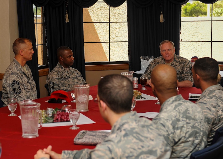Chief Master Sgt. of the Air Force James A. Cody has a discussion with Airmen during a meet and greet in the Thunderbird room located at the club on Nellis Air Force Base, Nev., July 27, 2016. While meeting with Airmen, Cody expressed his thanks to Airmen for their service and how they will be leading the force of the future while the Air Force continues to evolve in air, space and cyberspace. (U.S. Air Force photo by Senior Airman Jake Carter/Released)