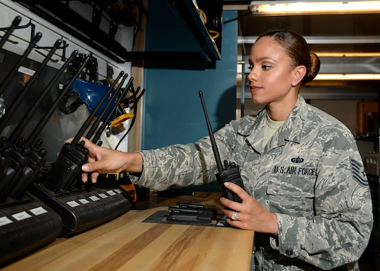 Sharry Barnshaw, 436th Communications Squadron client systems section chief, performs a routine inspection of two-way radios. Barnshaw was selected as one of the Air Force 12 Outstanding Airmen of 2015. (Courtesy photo)