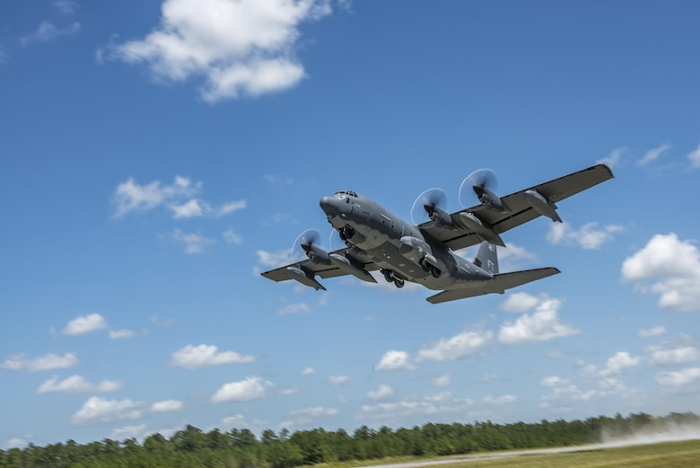 An HC-130J Combat King II from the 71st Rescue Squadron takes off from the Bemiss Field unimproved landing zone, July 29, 2016, at Grand Bay Bombing and Gunnery Range, Ga. This flight marked the first time an HC-130J landed at the ULZ on Bemiss Field, which was previously used for airdrops and helicopter landings. The landing validated the pilot's training for future operations in austere locations and met requirements for training that cannot be accomplished on paved runways or assault strips. (U.S. Air Force photo by Tech. Sgt. Zachary Wolf)