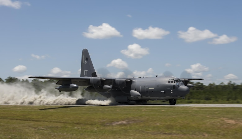 An HC-130J Combat King II from the 71st Rescue Squadron lands on the Bemiss Field unimproved landing zone, July 29, 2016, at Grand Bay Bombing and Gunnery Range, Ga. This flight marked the first time an HC-130J landed at the ULZ on Bemiss Field, which was previously used for airdrops and helicopter landings. The landing validated the pilot's training for future operations in austere locations and met requirements for training that cannot be accomplished on paved runways or assault strips. (U.S. Air Force photo by Tech. Sgt. Zachary Wolf)