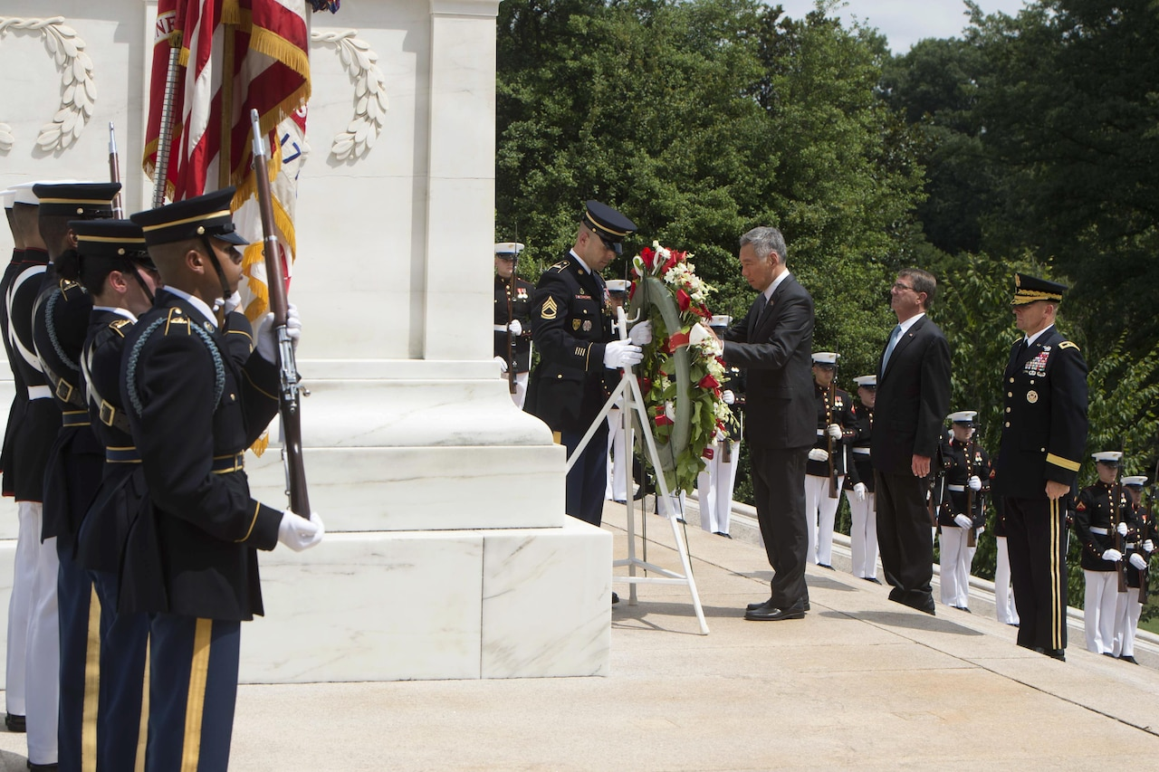 Defense Secretary Ash Carter, second from right, looks on as Singapore Prime Minister Lee Hsien Loong lays a wreath at the Tomb of the Unknown Soldier in Arlington National Cemetery in Virginia., Aug. 1, 2016. The two leaders met to discuss matters of mutual importance. DoD photo by Navy Petty Officer 1st Class Tim D. Godbee