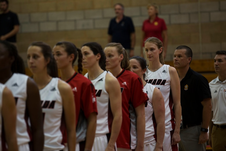 The Canadian Military Women's Basketball Team stands for the playing of Canada's and Brazil's national anthems before the Canada vs. Brazil game at the Conseil International Du Sport Militaire (CISM) World Military Women's Basketball Championship July 27 at Camp Pendleton, California. The base is hosting the CISM World Military Women's Basketball Championship July 25 through July 29 to promote peace activities and solidarity among military athletes through sports. (U.S. Marine Corps photo by Sgt. Abbey Perria)