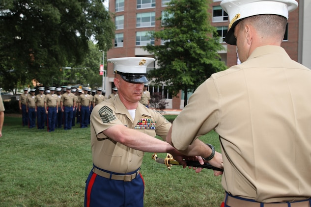 Sgt. Maj. Jonathan W. Clark receives the noncommissioned officer sword from Maj. Richard P. Neikirk, commanding officer of Recruiting Station Raleigh, during a relief and appointment ceremony June 30 at the North Carolina State University Memorial Bell Tower, NC. The passing of the sword signifies the transfer of sacred trust from one sergeant major to the other. Clark relieved Sgt. Maj. Jim E. Lanham who is to report to Okinawa, Japan, as the 31st Marine Expeditionary Unit sergeant major. (U.S. Marine Corps photo by Sgt. Antonio J. Rubio/Released)