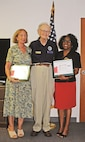 Marian Moore, left, a contract office representative, and Shirley Avant-Ferguson, an education services officer, each recently received the Employer Support of The Guard and Reserve Patriot Award July 25. The award was presented by retired Col. Verlyn Steinkruger, employer outreach representative for the Kansas Committee of ESGR.