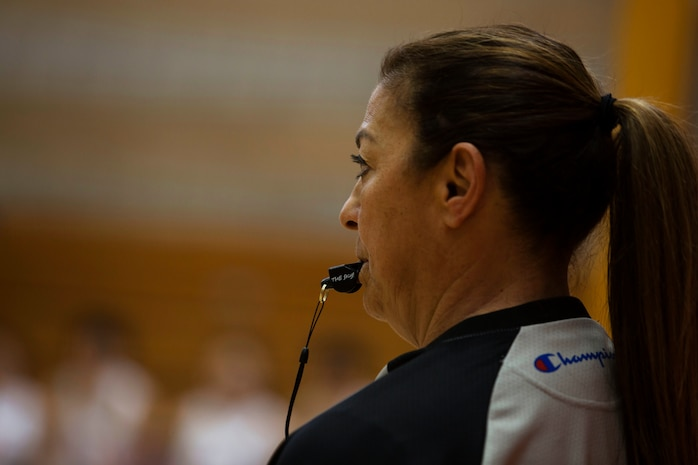 U.S. Referee Lolly Saenz Makes a call during the China vs. Canada game at the Conseil International Du Sport Militaire (CISM) World Military Women's Basketball Championship July 28 at Camp Pendleton, California. The base is hosting the CISM World Military Women's Basketball Championship July 25 through July 29.  The event is an opportunity for high-caliber U.S. service member athletes to be positively engaged with their peers from nations around the globe. (U.S. Marine Corps photo by Sgt. Abbey Perria)