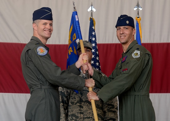 Col. Benjamin Bishop, 56th Operations Group commander, passes the guidon to Lt. Col. Matthew Vedder as he assumes command of the 63rd Fighter Squadron Aug. 1, 2016 at Luke Air Force Base, Ariz. The 63rd FS is scheduled to begin accepting F-35 Lightning II jets in March 2017 and will be joined by partner nation Turkey. (U.S. Air Force photo by Senior Airman Devante Williams)