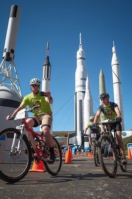 Steve Goolsby bikes around the Space and Rocket Center.