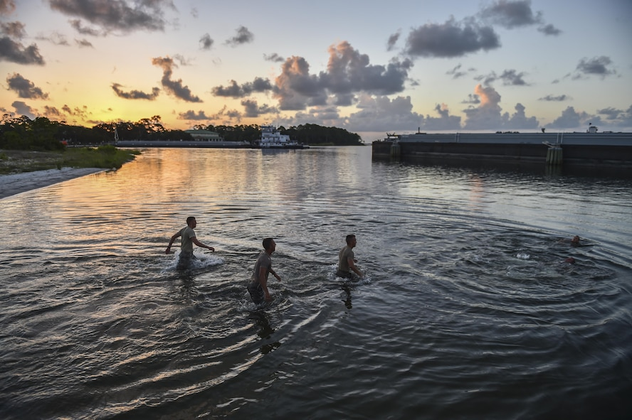 """Air Force ROTC cadets wade into the water during a physical training competition --called a """"monster mash""""-- at a Special Tactics orientation course at Hurlburt Field, Fla., July 29, 2016. Run twice a summer by the 24th Special Operations Wing, 48 cadets spent a week learning what it takes to become a Special Tactics officer. (U.S. Air Force photo by Senior Airman Ryan Conroy)"""