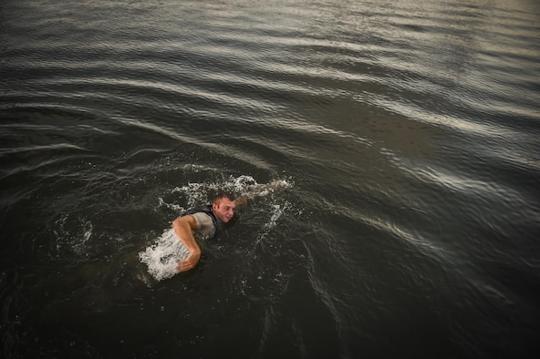 "An ROTC cadet swims during a physical training competition --called a ""monster mash""-- at a Special Tactics orientation course at Hurlburt Field, Fla., July 29, 2016. Run twice a summer by the 24th Special Operations Wing, 48 cadets spent a week learning what it takes to become a Special Tactics officer. (U.S. Air Force photo by Senior Airman Ryan Conroy)"