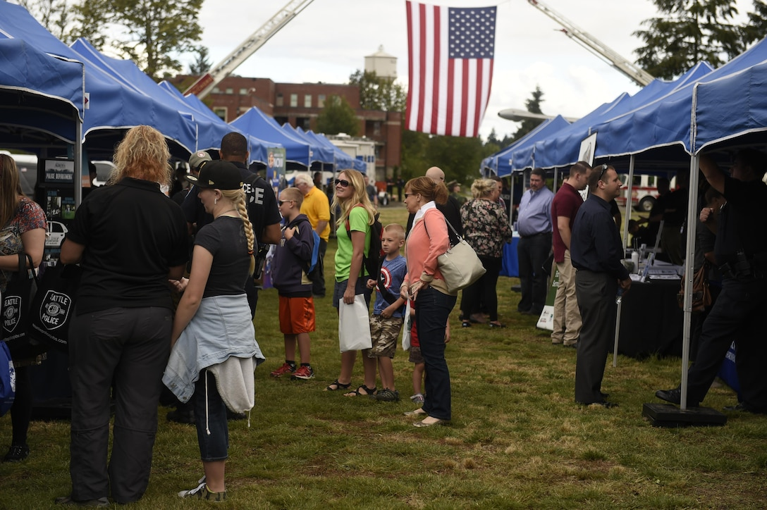 """Police Officers with the Seattle Police Department mounted division, answer questions from visitors at the """"Stand with Those Who Serve,"""" annual public safety appreciation event July 23, 2016 at Joint Base Lewis-McChord, Wash. 38 different first responder agencies participated in the event, to include city, county state and federal agencies. (U.S. Air Force photo/Tech. Sgt. Tim Chacon)"""