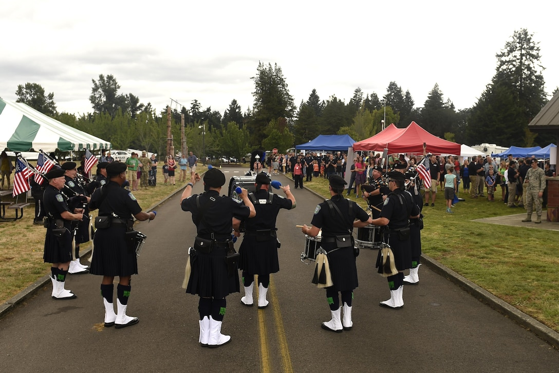 "Members of the Seattle Police Department Pipes and Drums band perform at the ""Stand with Those Who Serve,"" annual public safety appreciation event July 23, 2016 at Joint Base Lewis-McChord, Wash. The event is in its sixth year and has been held at JBLM for two consecutive years. (U.S. Air Force photo/Tech. Sgt. Tim Chacon)"