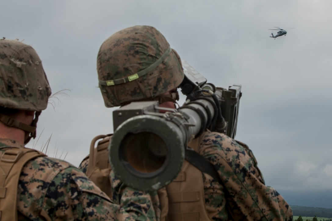 U.S. Marine Corps Cpl. Johnston Murn, a low altitude air defense gunner with 3rd LAAD Battalion unit deployment program, uses a Stinger missile tracking and handling trainer on a Sikorsky MH-60S Seahawk with Helicopter Sea Combat Squadron (HSC) 25 during Exercise Eagle Wrath 2016 at Combined Arms Training Center Camp Fuji, July 28, 2016. Marine Wing Support Squadron 171 stationed at Marine Corps Air Station Iwakuni, Japan, received assistance throughout the exercise from Combat Logistics Company 36 from MCAS Iwakuni, the Low Altitude Air Defense Battalion and Marine Air Traffic Control Mobile Team from the 31st Marine Expeditionary Unit and HSC-25 from Andersen Air Force Base, Guam. (U.S. Marine Corps photo by Lance Cpl. Aaron Henson)