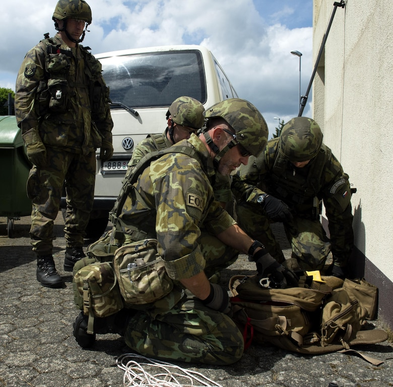 Army of the Czech Republic, explosive ordnance disposal members, prepare to disarm a simulated improvised explosive device during the IED Rodeo exercise at Spangdahlem Air Base, Germany, July 27, 2016. This multilateral exercise focused on locating and disarming improvised explosive devices which involved EOD members from the U.S., Czech Republic, Germany and Belgium. (U.S. Air Force photo by Airman 1st Class Preston L. Cherry/Realeased)