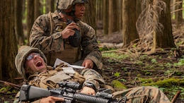 U.S. Marine Corps Cpl. Christian Marin, a heavy equipment mechanic with Marine Wing Support Squadron 171 stationed at Marine Corps Air Station Iwakuni, Japan, radios-in a simulated casualty during Exercise Eagle Wrath 2016 at Combined Arms Training Center Camp Fuji,Japan, July 28, 2016. During the culminating event, Marines established a mock air base including a landing zone and refueling point, constructed defensive and machine-gun positions, and conducted convoys and patrols over the course of four days. MWSS-171 conducts this exercise once a year in order to train all the Marines within the squadron, enhance their technical skills, field experience and military occupational specialty capability.