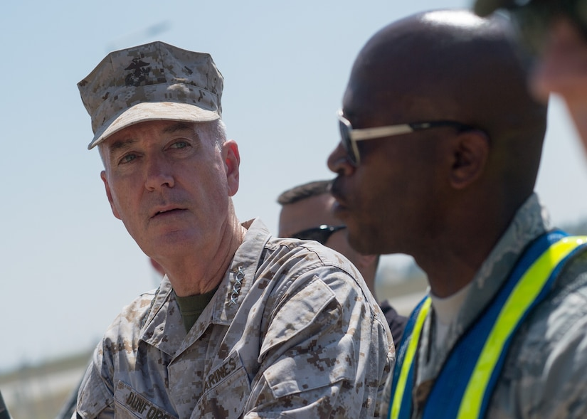 Marine Corps Gen. Joe Dunford, chairman of the Joint Chiefs of Staff, listens to Air Force Master Sgt. Gaston brief him as he observes airmen participating in a field exercise at Incirlik Air Base, Turkey, Aug. 2, 2016. DoD photo by Navy Petty Officer 2nd Class Dominique A. Pineiro
