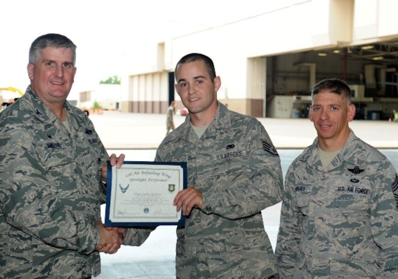 Staff Sgt. Cody Nelson, 22nd Aircraft Maintenance Squadron aerospace propulsion craftsman and assistant flying crew chief, poses with Col. Albert Miller, 22nd Air Refueling Wing commander, and Chief Master Sgt. Shawn Hughes, 22nd ARW command chief, July 28, 2016, at McConnell Air Force Base, Kan. Nelson received the spotlight performer for the week of May 30 – June 3. (U.S. Air Force photo/Senior Airman David Bernal Del Agua)