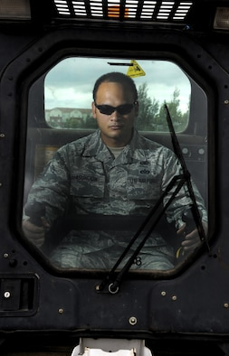 """Tech. Sgt. Michael Asuncion Jr, 5th Bomb Wing NCO in charge of administration, sits in a Bobcat skid steer at Minot Air Force Base, N.D., July 12, 2016. Asuncion was named one of the 12 Outstanding Airmen of the Year for 2015 when he was a """"dirt boy"""" at Patrick AFB, Fla. (U.S. Air Force photo/Airman 1st Class Christian Sullivan)"""