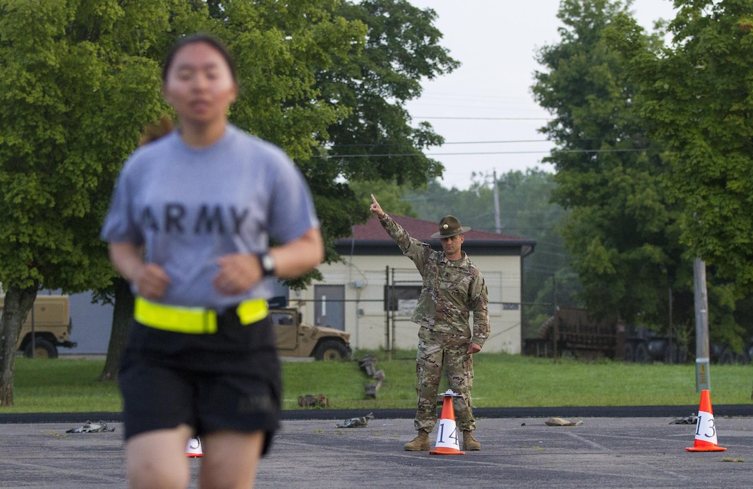 Army Reserve drill sergeants from Task Force Wolf grade Cadets performing the aerobic interval run for the Occupational Physical Assessment Test (OPAT) at U.S. Army Cadet Command during Cadet Summer Training (CST16), Ft. Knox, Kentucky, July 25. (U.S. Army Reserve photo by Sgt. Karen Sampson/ Released)