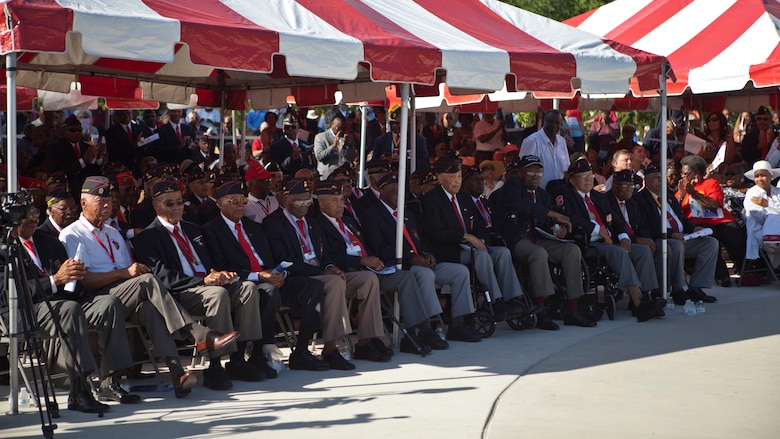 U.S. service members and guests attend the Montford Point Marine Memorial dedication ceremony held at Jacksonville, North Carolina, July 29, 2016.The memorial was built in honor of the 20,000 African-Americans who attended training at Montford Point.