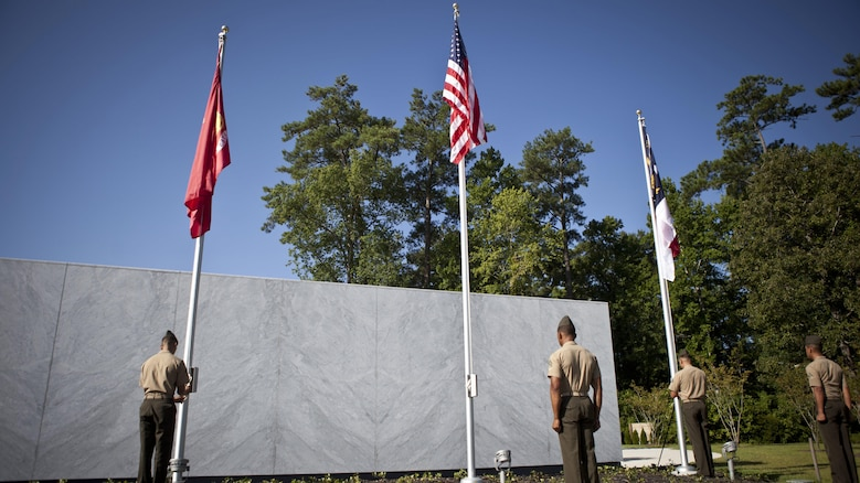 U.S. service members and guests attend the Montford Point Marine Memorial dedication ceremony held at Jacksonville, North Carolina, July 29, 2016. The memorial was built in honor of the 20,000 African-Americans who attended training at Montford Point.