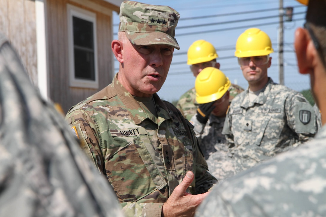 More than a dozen students and instructors from the second phase of the 80th Training Command's carpentry and masonry specialist course met with Lieutenant General Charles D. Luckey, the commanding general of the United States Army Reserve, for an impromptu question and answer session at Tactical Training Center Dix,  Fort Dix, N.J. July 16, 2016. With numerous courses taught over a twelve month period, instructors at TTC Dix train about 150 soldiers every calendar year in construction, carpentry and masonry, electrical engineering, and plumbing.