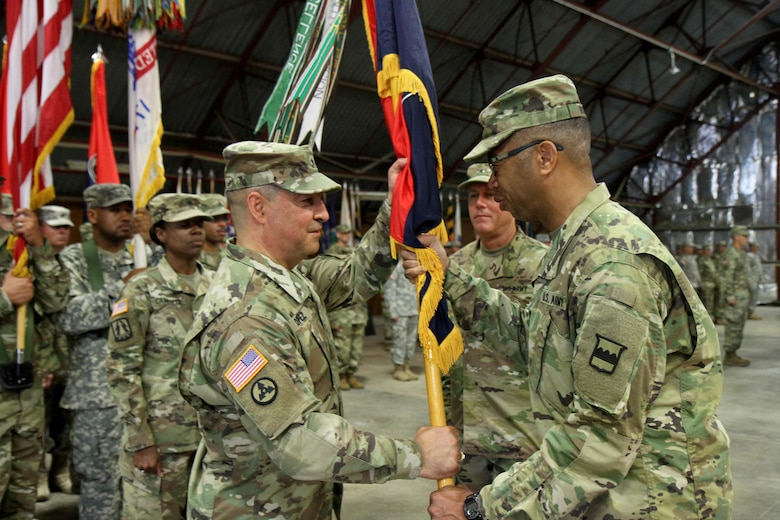 Brig. Gen. Hector Lopez, incoming commander of the 94th Training Division (Force Sustainment), accepts the division's colors from the commanding general of the 80th Training Command (TASS), Maj. Gen. A. C. Roper, during a change of command ceremony at Fort Lee, Va., July 23, 2016.  The 94th provides world class training in the career management fields of Ordnance, Transportation, Quartermaster, and Human Resources, ensuring all service members are properly trained, fed, supplied, and maintained.