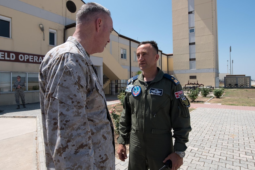 Marine Corps Gen. Joe Dunford, left, chairman of the Joint Chiefs of Staff, speaks with Turkish Air Force Brig. Gen. Kemal Turan.