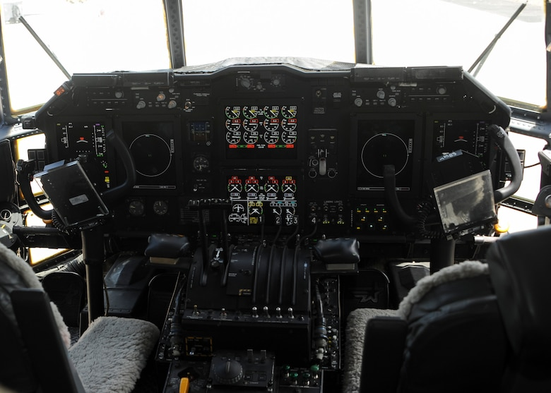 A cockpit upgraded via an avionic viability is powered on for demonstration in an EC-130H Compass Call at Davis-Monthan Air Force Base, Ariz., July 19, 2016. The upgrade revitalizes the cockpit with liquid crystal displays that consolidate vital flight information such as precision ground mapping. (U.S. Air Force photo by Airman Nathan H. Barbour/Released)
