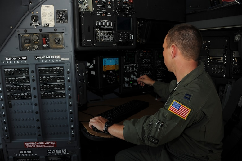 U.S. Air Force Capt. Gregory Jackson, 42nd Electronic Combat Squadron assistant director of operations, demonstrates the upgraded navigation system in an EC-130H Compass Call at Davis-Monthan Air Force Base, Ariz., July 19, 2016. With new radar upgrades provided via an avionic viability program, the EC-130H has improved navigation performance in order to sharpen tactics, techniques and procedures for precision electronic attack. (U.S. Air Force photo by Airman Nathan H. Barbour/Released)