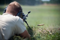 An 11th Security Support Squadron Combat Arms instructor shoots a Barrett M107 rifle at Marine Corps Base Quantico, Va., July 15, 2016. Joint Base Andrews combat arms instructors shot two weapon systems to familiarize themselves with the weapons to instruct other service members requiring sniper training. (U.S. Air Force photo by Airman 1st Class Philip Bryant)