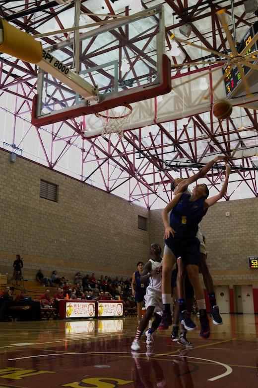 Players from team U.S.A. and team Brazil leap for the ball during the final game of the Conseil International Du Sport Militaire (CISM) World Military Women's Basketball Championship July 29 at Camp Pendleton, California. The tournament ended July 29, with Brazil winning the gold. U.S.A took second place, and China will return home with the bronze. The base hosted the CISM World Military Women's Basketball Championship July 25 through July 29 to promote peace activities and solidarity among military athletes through sports.  Teams from Canada, France, and Germany also participated.  (U.S. Marine Corps photo by Sgt. Abbey Perria)