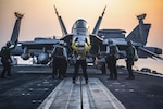 An F/A-18C Hornet taxis onto the catapult on the flight deck of the aircraft carrier USS Dwight D. Eisenhower, July 31, 2016. The Eisenhower is supporting Operation Inherent Resolve, maritime security operations and theater security cooperation efforts in the U.S. 5th Fleet area of operations. Navy photo by Petty Officer 3rd Class J. Alexander Delgado