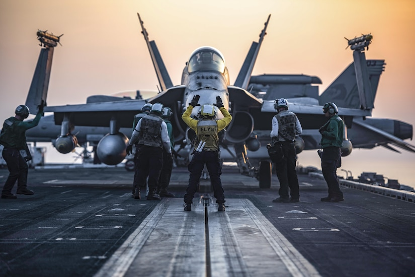 An F/A-18C Hornet taxis onto the catapult on the flight deck of the aircraft carrier USS Dwight D. Eisenhower in the Arabian Gulf, July 31, 2016. The Eisenhower is supporting Operation Inherent Resolve, maritime security operations and theater security cooperation efforts in the U.S. 5th Fleet area of operations. Navy photo by Petty Officer 3rd Class J. Alexander Delgado