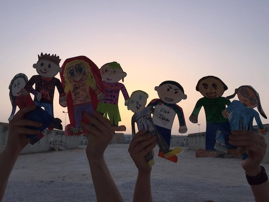 A KC-135 Stratotanker crew consisting of Airmen from McConnell Air Force Base, Kan., hold up Flat Stanleys, June 2016, at a deployed location. The Flat Stanleys, created by a class of second graders from Columbus Elementary School, McMinnville, Oregon, deployed with Airmen from the 384th, 350th and 349th Air Refueling Squadrons. (Courtesy photo)