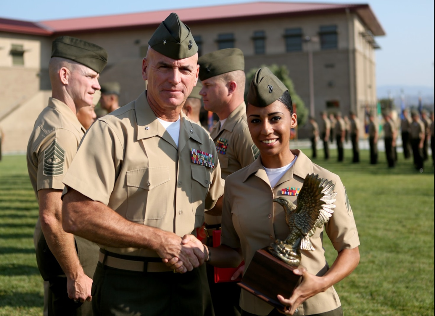 U.S. Marine Brig. Gen. David A. Ottignon presents Sgt. Lara Deleon with the I Marine Expeditionary Force Navy and Marine Corps Association Leadership Award at the 1st Marine Logistics Group quarterly awards ceremony aboard Camp Pendleton Calif., July 29, 2016. Ottignon is the 1st MLG commanding general and Deleon is a maintenance chief with Headquarters Regiment. Deleon was one of the Marines recognized at the ceremony for their outstanding achievements in the performance of their duties for the fiscal year 2016 third quarter. (U.S. Marine Corps photo by Sgt. Carson Gramley/released)