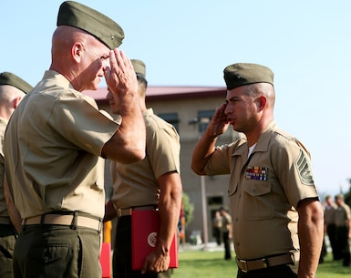 U.S. Marine Gunnery Sgt. Pablo Hernandez renders a salute to Brig. Gen. David A. Ottignon at the 1st Marine Logistics Group quarterly awards ceremony aboard Camp Pendleton Calif., July 29, 2016. Ottignon is the 1st MLG commanding general and Hernandez is an operations chief at 7th Engineer Support Battalion. Hernandez was one of the Marines recognized at the ceremony for their outstanding achievements in the performance of their duties for the fiscal year 2016 third quarter. (U.S. Marine Corps photo by Sgt. Carson Gramley/released)